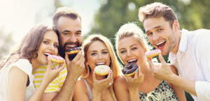people eating donuts on a sunny day
